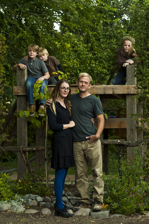 Chris Detrick | The Salt Lake Tribune Phil Sherburne and his wife Leia Bell pose for a portrait with their kids Cortez, 11, Oslo, 6, and Ivan, 9, at their home in Salt Lake City Wednesday October 9, 2013. Sherburne and Bell, owners of the frame and art store called Signed & Numbered, succeeded last weekend in signing up for health coverage on healthcare.gov.