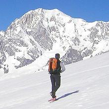 snowshoer with mountain background- Alps