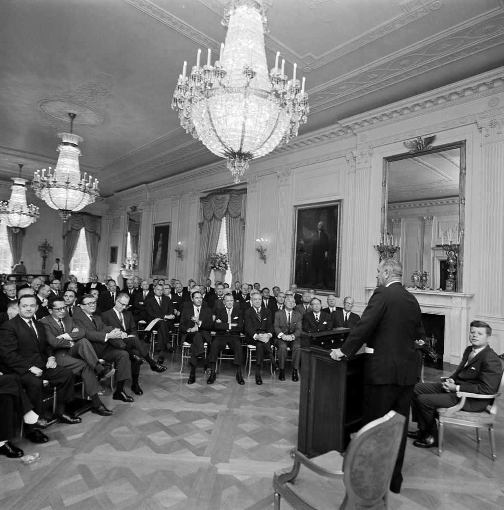 June 4, 1963:  Business leaders listening to Vice President Lyndon B. Johnson, with President John F. Kennedy, in the White House.  Photo from the Kennedy Library, public domain