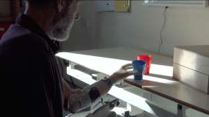 Handling cups with a myoelectric arm