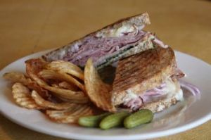 A ham sandwich with brie, red onion, spinach, a dijonaise sauce and chips is a popular item on the lunch menu at Mamie's. John McKenna Republican-American