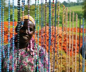 Sharon Perun, owner of Beads and More in Woodbury, holds some of the beads she sells for Beads for Life, an organization that helps eradicate poverty in Uganda. The women in Uganda make the beads and the organization gets the money back to them directly. Republican-American archive