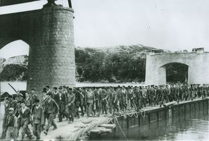 A line of American soldiers taken prisoner early in the war in Korea marches north to prison camps over a temporary bridge across the Han River near the South Koren capital city of Seoul. The city, now in U.N. hands, then was held by Red Forces. Life Magazine said it obtained this picture from a source and under circumstances which it could not reveal. However a poor quality print from the same negative was distributed in August 1950, by the Russian-controlled German news agency ADN and was serviced from New York on August 19, 1950. AP Photo from Life Magazine.