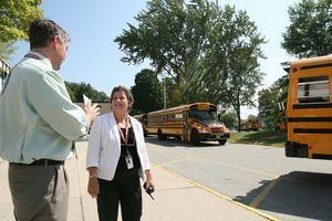 Torrington High School Principal Joanne Creedon chats with paraprofessional Mike Deleppo Tuesday as the buses depart following the first day of school. Jim Moore Republican-American.
