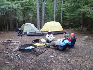 In really popular backcountry campsites like this one in the White Moutain National Forest of New Hampshire, tent platforms and fire rings help to concentrate impact into a smaller area, sparing the surroundings. Tim Jones
