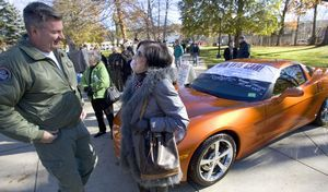 From left, Charles Loya of Torrington meets Anne MacDonald-Borghesi of Torrington during the Veterans Day ceremonies in Torrington Thursday. Loya returned from Iraq in July and was with a group from Westover Ma. Borghesi donated the car that was raffled off to raise money for Veterans Memorial Wall. Steven Valenti Republican-American