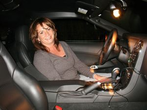 Debra Testa poses inside her 2009 Corvette she won in the City Hall Veterans Memorial Wall raffle, which raised $85,000. Testa won the car after buying a single ticket, and Mayor Ryan J. Bingham and Royals Garage owner Glenn Royals delivered the car to Testa's home on Tuesday. Kevin Litten / Republican-American