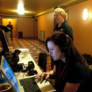 Shayna Drinkuth, left, a photo and video specialist with RISEUP, a paranormal investigation group, and investigator Julie DeMay check the position of cameras inside the Warner Theatre in Torrington on Sunday as they set up for a fundraiser hosted by RISEUP Paranormal Connecticut. The event allowed 50 people to do an investigation in the theater to look for paranormal activity. Jim Shannon/RA