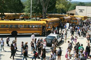 Torrington High School students board buses at the conclusion of their first day of classes on Aug. 31, 2010. The school is preparing for a freshman class with 50 or more students repeating the grade, and fellow students are stepping up to help their peers this year. File photo.