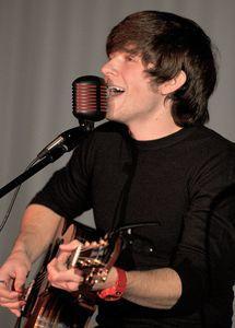 American Idol contestant Tim Urban sings during a benefit concert Sunday at Torrington High School. Jim Shannon/RA