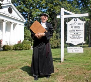 The Rev. Stuart C. Brush donning colonial garb as he holds the Holy Bible from 1769 outside of the United Church of Christ in Southbury as they prepare to celebrate the church's 280th anniversary. The celebration will be Sept. 30. The observance will re-enact religious and community life in the colonial beginnings of Southbury.  Darlene Douty Republican-American