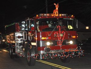 Kent's Grumman pumper was one of the many trucks that shone bright during the second annual Parade of Lights on Main Street Saturday, sponsored by the Kent Volunteer Fire Department. Lynn Mellis Worthington Republican-American