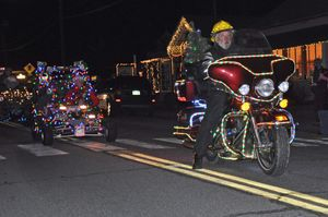 Kent resident Dominique Limbos on his motorcycle was one of the many individuals who joined in the Parade of Lights, sponsored by the Kent Volunteer Fire Department on Main Street Saturday evening. Limbos has two sons who are emergency members in the department. Lynn Mellis Worthington Republican-American