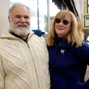 Matthew Valenti and his wife, Barbara Valenti stand in front of the Warner Theatre in Torrington. Steven Valenti / Republican-American