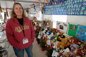 Chaplain Renee Gilbert is on hand to greet guests at gathering place just off I-84 at Exit 10 in Newtown Wednesday. The tent that sprang up just after the Sandy Hook Elementary School shooting has become a place for people to mourn the victims. Steven Valenti / Republican-American