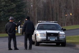 State police troopers block off a section of Yogananda Street in Newtown near a house belonging to Nancy Lanza, the mother of Adam Lanza, who killed 26 people in a shooting rampage at Sandy Hook Elementary School in Newtown on Dec. 14. Activists are counting on the Sandy Hook effect to overcome opposition to stronger gun laws in Connecticut. AP Photo/Jason DeCrow, File