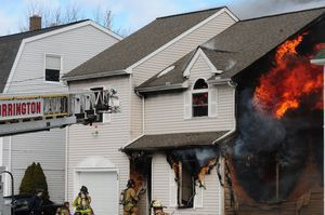 Flames shoot from the second story of 64 Griswold St. in Torrington on Monday. Alec Johnson/RA