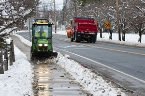 Danny Martin with the Canaan Fire District, clears snow from the sidewalks on Railroad Street (Route 7) in Canaan following a snowstorm on Friday. Martin said the fire district is responsible for clearing the sidewalks and fire hydrants in town.  Jim Shannon Republican-American