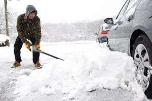 Edmond Ewins of Waterbury shovels out his car Friday along Earl Street. Erin Covey Republican-American.