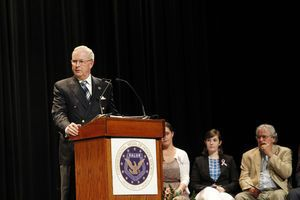 Tom Wilkerson, president of the Medal of Honor Foundation, gives an introduction during a ceremony at Newtown High School on Monday afternoon. Family members representing the six adult victims of the Sandy Hook Elementary School shootings received citizen honor medals honoring their loved ones posthumously. The medals were bestowed by Congressional Medal of Honor recipients during the ceremony. Christopher Massa/RA