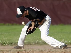 Southbury, CT- 03 June 2013-070313CM09- Oakville's Daniel Brodeur tries to secure a grounder during American Legion Zone 5 action against Naugatuck at Pomperaug High School Wednesday afternoon. Christopher Massa Republican-American