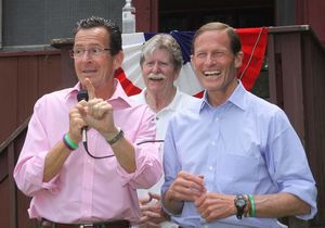 Gov. Dannel P. Malloy, left, with U.S. Sen. Richard Blumenthal, right, and Morris Democratic Town Committee Chairman Larry Sweeney looking on, addresses the crowd during the Democratic outing at the Morris Town Beach on Saturday.  John McKenna photo