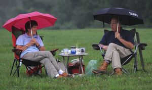 Bob and Claudia Buick of Goshen came armed with umbrellas for the opening night performances of the Litchfield Jazz Festival at the Goshen Fairgrounds on Friday.