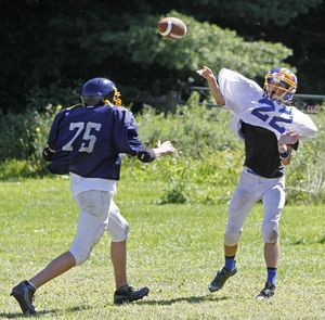 Falls Village, CT-24 August 2013-082413MK08 Housatonic's Jeremy Stiewing looks to throw over the rush from a defender during a scrimmage against Oliver Wolcott Technical at Housatonic Valley Regional High School on Saturday morning Falls Village. Michael Kabelka / Republican-American