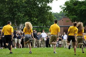 Dressed in yellow shirts, mentors and faculty at Oliver Wolcott Technical High School dance to a routine Wednesday in front of the incoming freshmen, who are in blue shirts. Over two dozen seniors became mentors to the ninth-graders. The new program is to help freshmen navigate classes and easily get information from seniors to whom they are assigned. Erin Covey Republican-American.