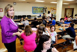 Kristin Bernier, appointed Aug. 19 as principal of Thomaston Center School meets students in the cafeteria on the first day classes Wednesday. Alec Johnson/ Republican-American