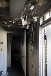 A fire a few years back shows damage in the back door entrance of 66 Buckingham Street in Waterbury. The building is leased by the city to an Orthodox Jewish sect. Erin Covey Republican-American.