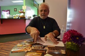 Tony Palmieri, owner of Tony's Barber Shop on Main Street, took dozens of photos of his old-style shop before he retired last week. Alexa Gorman Republican-American
