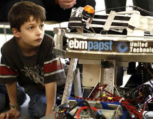 Eric Greenberg, 7, of Southbury checks out a robot brought in by Nonnewaug High School's robotics team at the Woodbury Public Library Saturday afternoon. Christopher Massa Republican-American