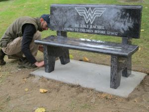 Neal Burton of Burton's Monument Shop in Waterbury finishes the installation of a bench in Bethlehem's town green in memory of Rachel D'Avino, one of the six educators killed in the Dec. 14 shooting at Sandy Hook Elementary School in Newtown. Rick Harrison Republican-American
