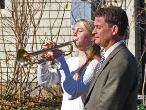 Kent Center School eighth-grader Alice Benjamin performed taps next to her father, Michael, during the Veterans Day ceremony Monday morning at the Veterans Memorial in Kent. Veterans performed a 21-gun salute and a few words were shared to remember those who have served the country in the armed services. Lynn Mellis Worthington/RA