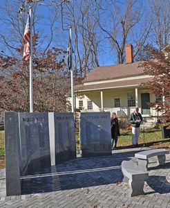 First Selectman Bruce K. Adams shares some thoughts during the Veterans Day ceremony Monday morning at the Veterans Memorial in Kent. Veterans performed a 21-gun salute and a few words were shared to remember those who have served the country in the armed services. Lynn Mellis Worthington/RA