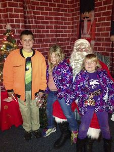 Telling their Christmas wishes to Santa at the Geer Holiday Fair in Canaan Saturday are: from left, Logan Cables, 10, Karyssa Rosier, 5 and Myranda Cables, 8, all of Canaan. Ruth Epstein Republican-American