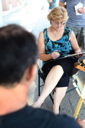 TORRINGTON, CT - 16 July 2015-071615EC02-- Judy Tourangeau with JT Art & Design draws a caricature at the weekly event in Torrington, called The Marketplace. Erin Covey Republican-American.