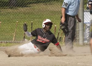 WATERBURY, CT--- -072215JS05-- Waterbury's Tyriq Harris (5) slides in safely at home to score during their American Legion tournament game against Greenwich Wednesday at Bucks Hill Park in Waterbury.   Jim Shannon Republican-American
