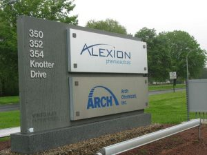 A sign marks the entrance to Alexion Pharmaceutical's headquarters on Knotter Drive in Cheshire. The company today reported an increase in earnings for the second quarter yet a decrease in profits for the fitst half of 2015. Republican-American Archives