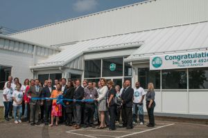 Workers and dignitaries cut the ribbon to officially open the new location of ECI Screeprint, Inc. in Watertown Thursday. Laraine Weschler Republican-American