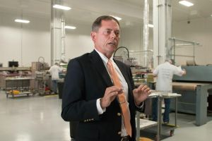 Edward F. Cook Jr., president of ECI Screenprint, Inc. gives a tour of the manufacturer's new location in Watertown Thursday. Laraine Weschler Republican-American