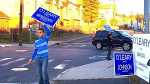 Ten-year-old Christian Rivera stood on a prominent South End corner in Waterbury's 5th District on Election Day urging people to vote. District elections brought this long-neglected, heavily-Hispanic part of the city its first seats on the Board of Aldermen in decades. It also put two Hispanics, and four minorities in total, on the board, more than ever before. Penelope Overton Republican-American