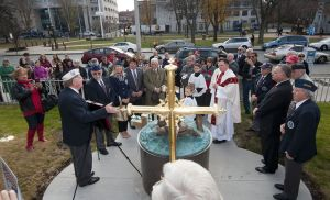 Bob Dorr of the Waterbury Veterans Memorial Committee, left, speaks to the guests following the blessing of the Father Thomas M. Conway Memorial at the Basilica of the Immaculate Conception by the The Very Rev. Christopher M. Ford, during a ceremony on Monday.  Jim Shannon Republican-American