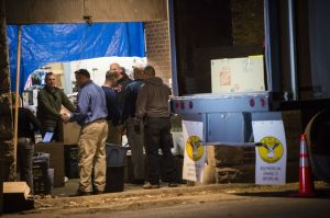 Erin Covey Republican-American A team of Waterbury police investigators loads up a trailer Thursday night with items found at 1694 North Main Street in Waterbury.