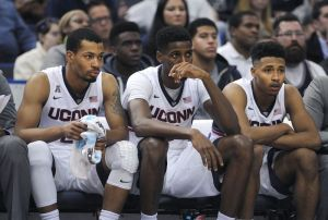 Connecticut's Omar Calhoun, Kentan Facey, and Jalen Adams, left to right, react during the second half of their team's 55-53 loss to Temple in an NCAA college basketball game in Hartford, Conn., on Tuesday, Jan. 5, 2016. (AP Photo/Fred Beckham)