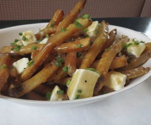 A popular dish at B & F in Lakeville is poutine, which consists of frites and cheese curds covered in a light brown gravy. Credit: Ruth Epstein