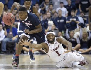 Connecticut guard Sterling Gibbs (4) steals the ball from Temple guard Josh Brown (1) during the first half of an NCAA college basketball game in the semifinals of the American Athletic Conference men's tournament in Orlando, Fla., Saturday, March 12, 2016. (AP Photo/Phelan M. Ebenhack)