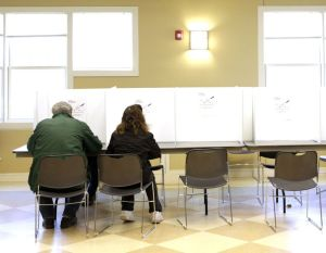 Voters cast their ballots inside the Woodbury Senior Center on Tuesday. Town residents came out to vote on the proposed Aquarion Reservoir purchase. Christopher Massa Republican-American