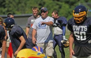 Falls Village, CT-24 August 2013-082413MK02 Oliver Wolcott Technical School's coach Jamie Coty instructs his team during a scrimmage against Housatonic at Housatonic Valley Regional High School on Saturday morning Falls Village. Michael Kabelka / Republican-American